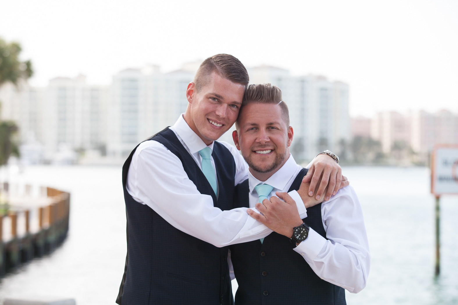 Groomsmen of wedding posing for a photo with intracoastal background