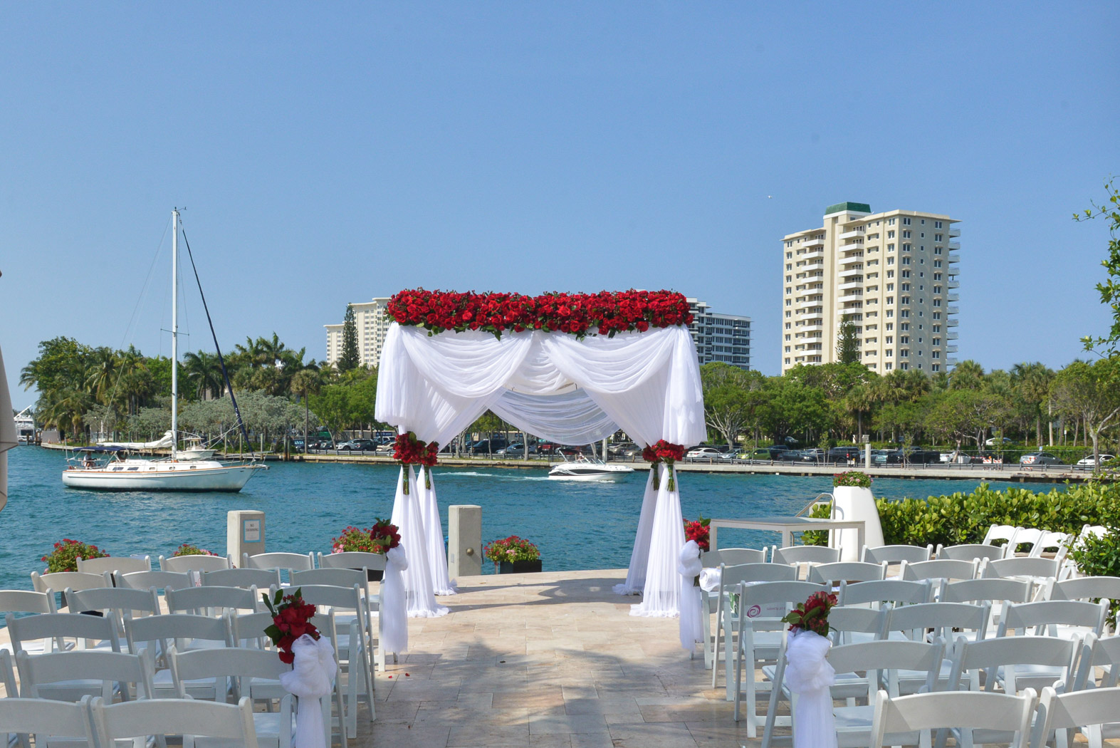 Wedding on the water with chairs & aisle toward altar