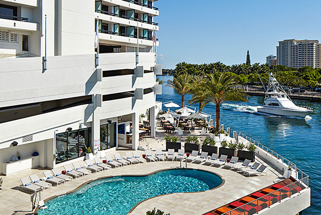 Pool area on intracoastal with red and orange loungers