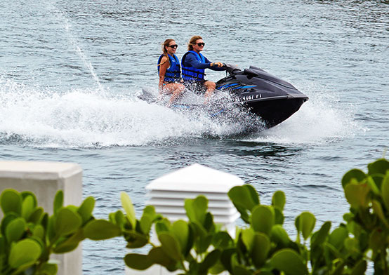 Couple riding on jetski in water