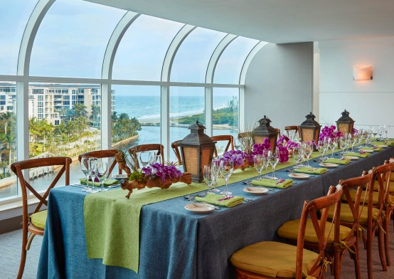 Elongated table set for dinner with a view of the intracoastal