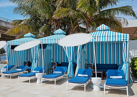 Light blue cabanas with dark blue loungers