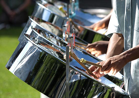 Close up of group of people playing steel drums