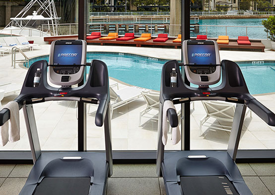 Treadmills facing window toward pool