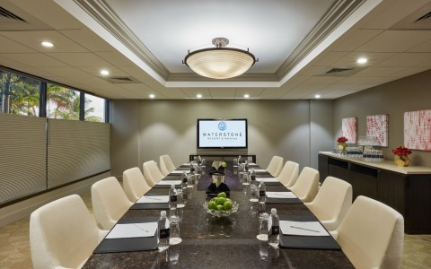 Long tables with chairs & projection screen