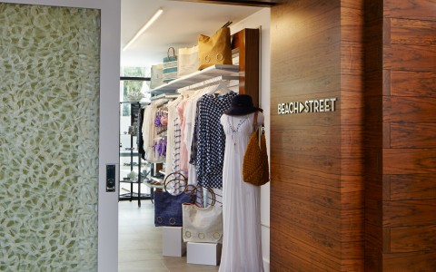 Entrance to beach street boutique, showing rack of garments