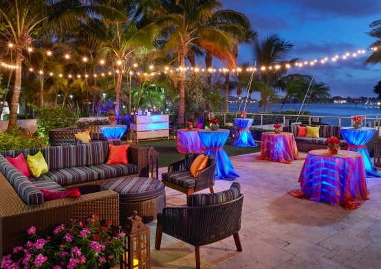 Outdoor lounging area with colorful chairs & tables