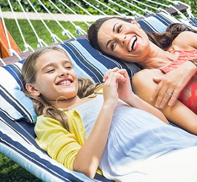 Mother & daughter laughing on hammock