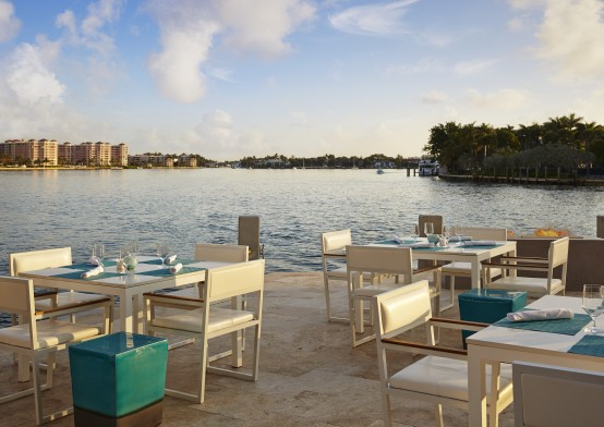 simple modern outdoor dining area facing intracoastal