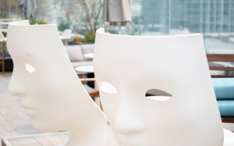 chairs with faces on a patio