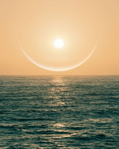 ring around sun during sunset over the ocean