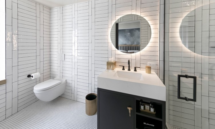 urban king bathroom all white tile, circle mirror