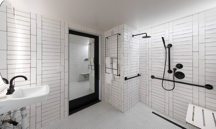 ADA two queen studio bathroom with shower