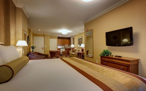 large hotel room with living room area and dining area