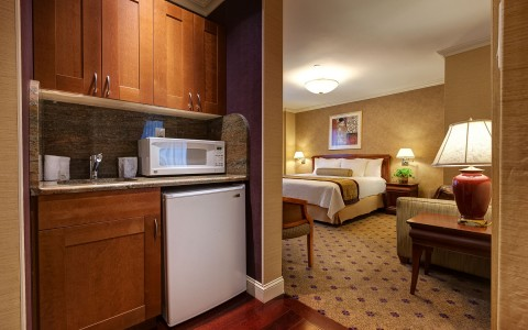 hotel room with small kitchen area