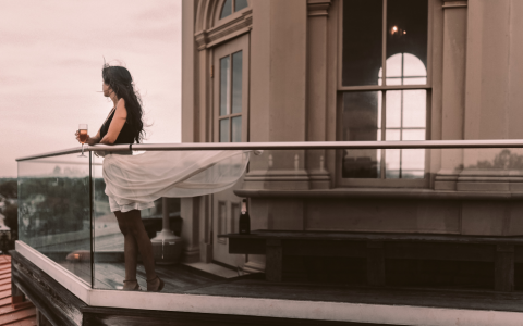 Lady on the rooftop of Wentworth Mansion