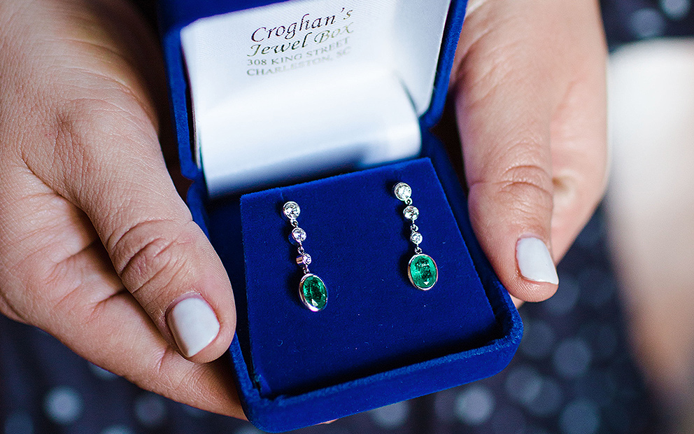 Emerald earrings in blue box from Croghans Jewel Box