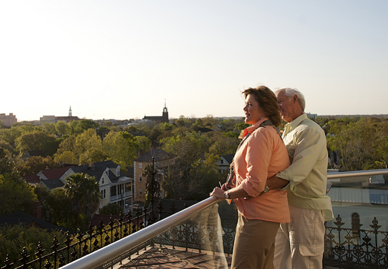 Couple on rooftop overlooking city