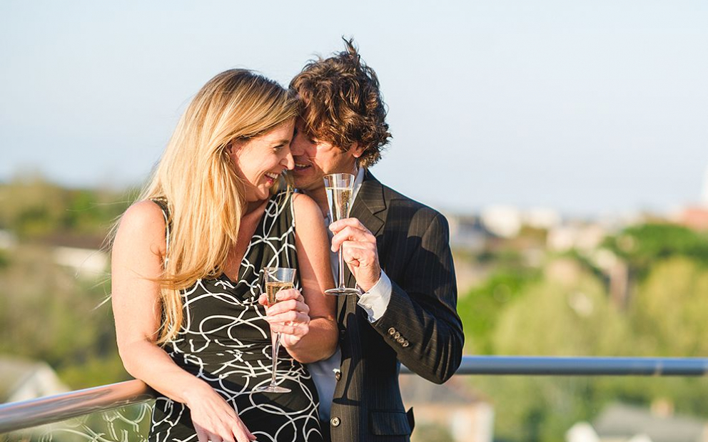 Couple on rooftop with champagne glasses