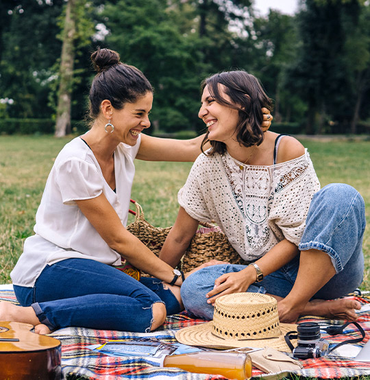 two women having a picnic together