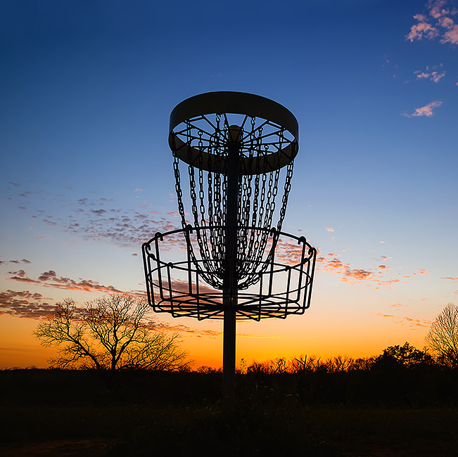 Disc golf at sunset