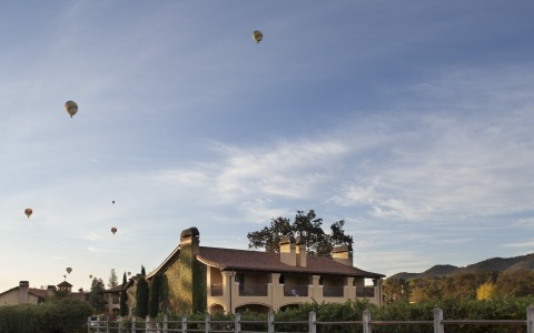 exterior shot of the property capturing colorful hot air balloons in the sky