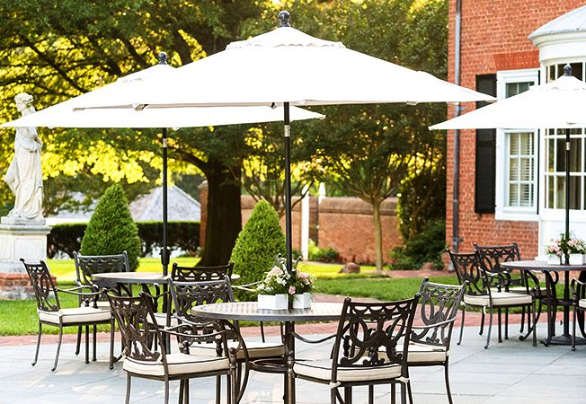 Outdoor metallic seating on terrace with umbrellas