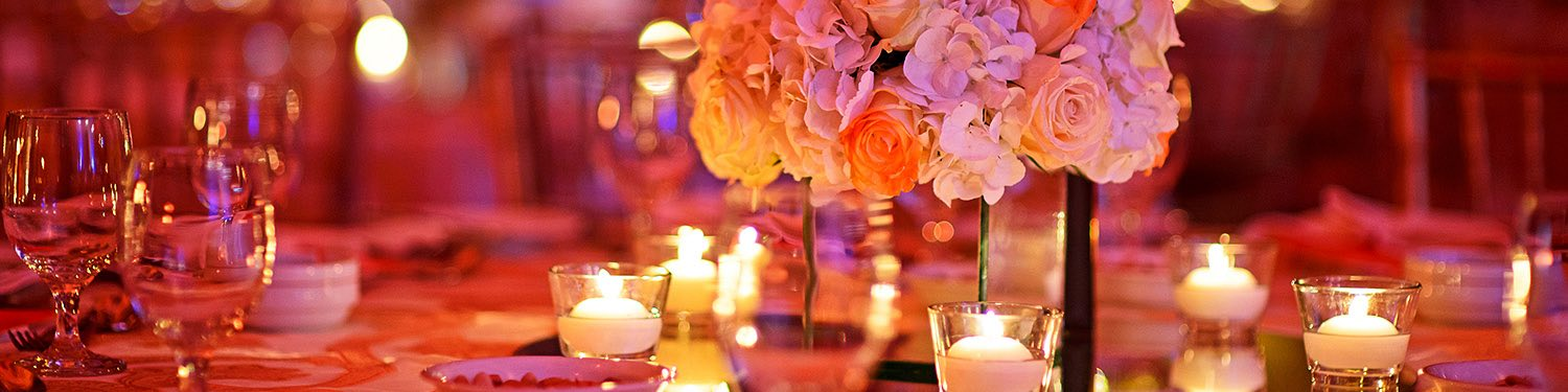 Wedding reception table setting with flowers and candles