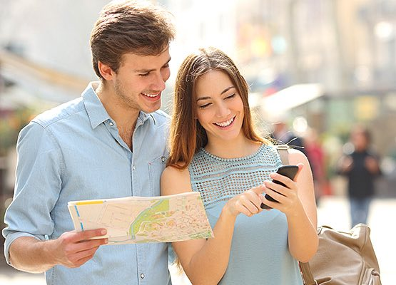 Couple looking at a map and a mobile phone