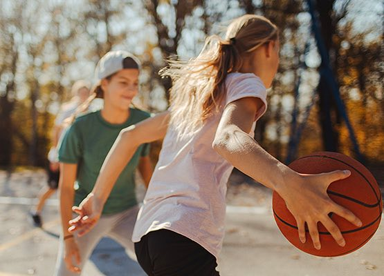 Girls playing basketball outside