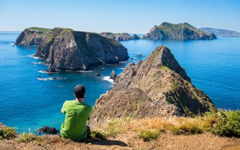man overlooking the channel islands