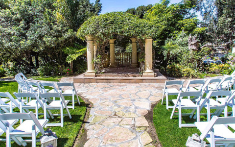 Wedding set up outside with lush surroundings
