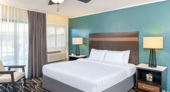 king bed with blue wall and striped headboard