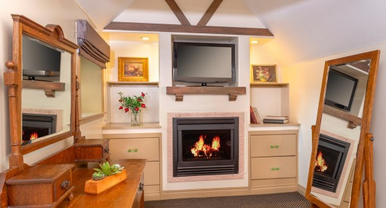 fireplace with tv and mirrors