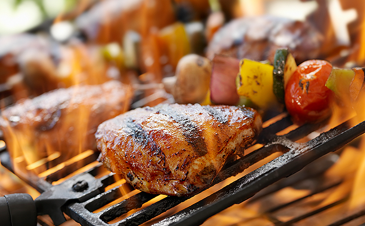 chicken and vegetable kebobs being cooked on a grill