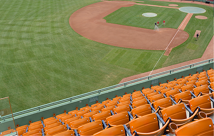 rows of seats at a baseball stadium looking onto the field