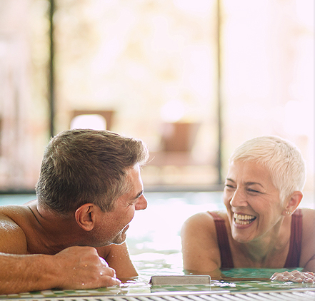 older man and woman at the indoor pool together