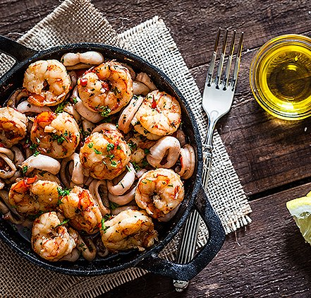 shrimp and calamari in a cast iron skillet