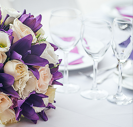 purple and white flowers laying on a table