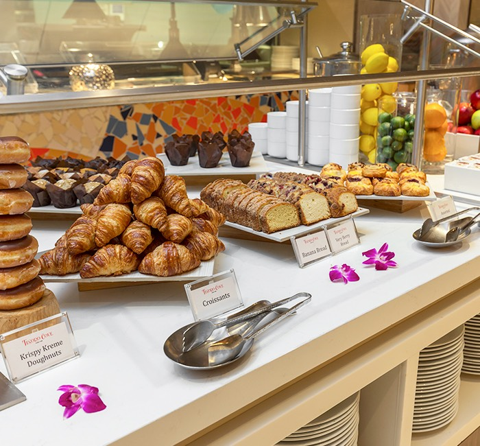a buffet with assorted breakfast food