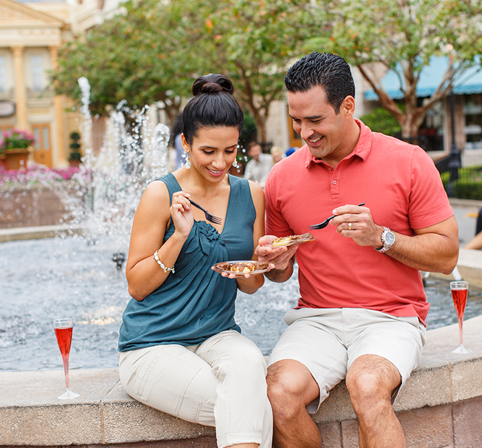 A couple enjoying a meal during the food and wine festival at Epcot