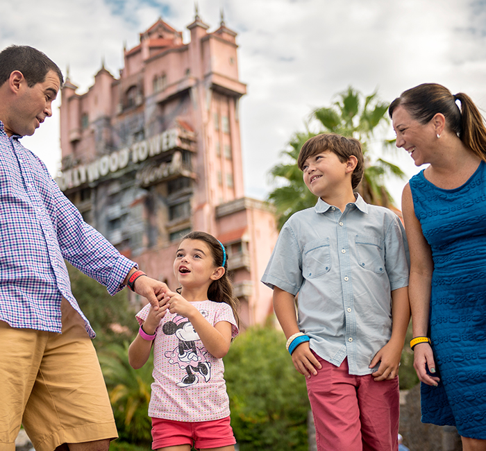 A family walking in front of Disney's Hollywood Studios