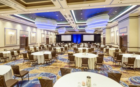 a large conference room to fit a large group with tables set up for dining capabilities