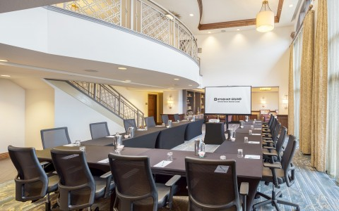 an open meeting room perfect for a smaller panel of guests and speakers