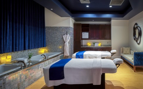 a spa room with two massage beds, perfect for couples massages