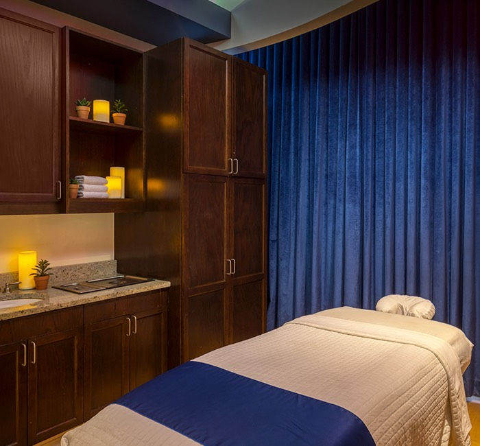 inside the spa's massage room with a relaxing energy and soft lighting for peacefulness