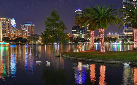 night view of lake with downtown Orlando in background