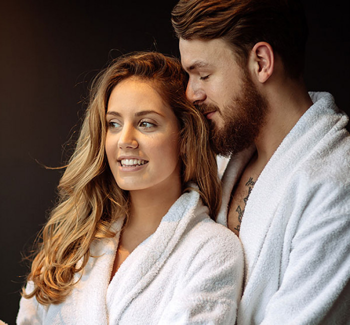 couple embracing in white spa robes
