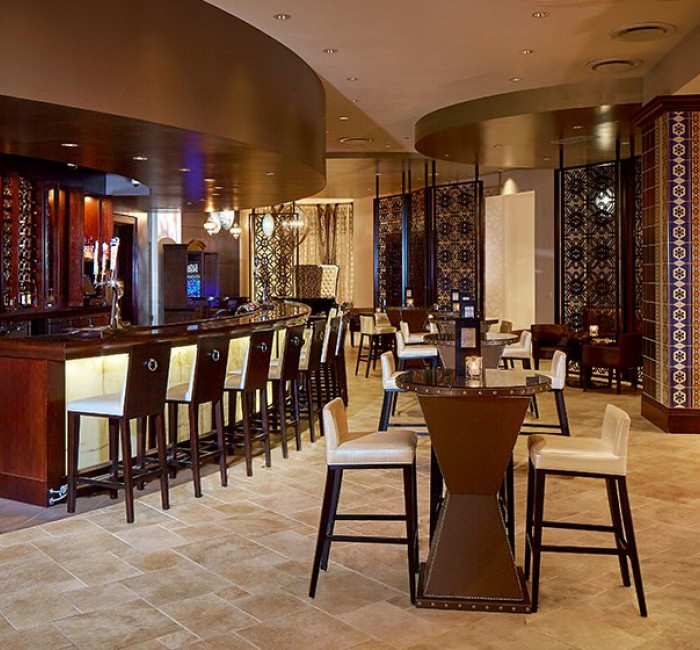 hotel bar area with bar seating and curved walls
