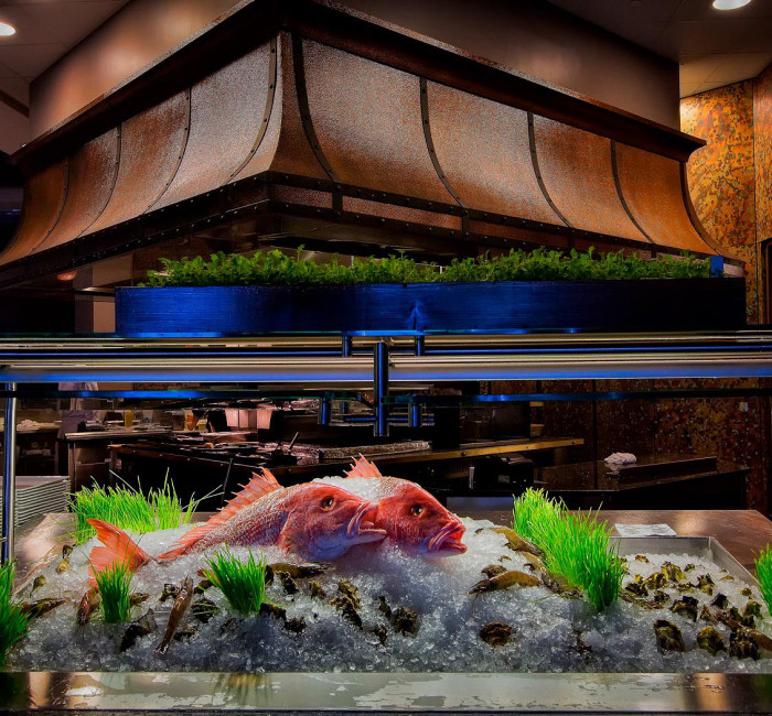 display case at Deep Blu restaurant showcasing a large red fish on ice